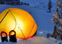pitching tent in a snow
